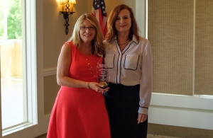 President Angela Daniels, right, presented the 'Member of the Year' award to Cindi Lane, APR.