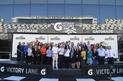 The 2017 Volusia/Flagler FPRA Media Day participants pose in winner's circle at the Daytona Speedway.