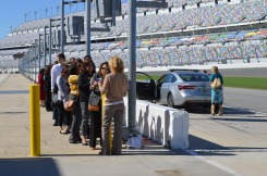 Media Day 2017 participants excitedly await their turns for a hot lap around the Daytona Speedway track.